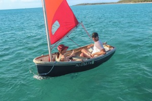 Scott and Sara sailing the dinghy off Nomans Cay
